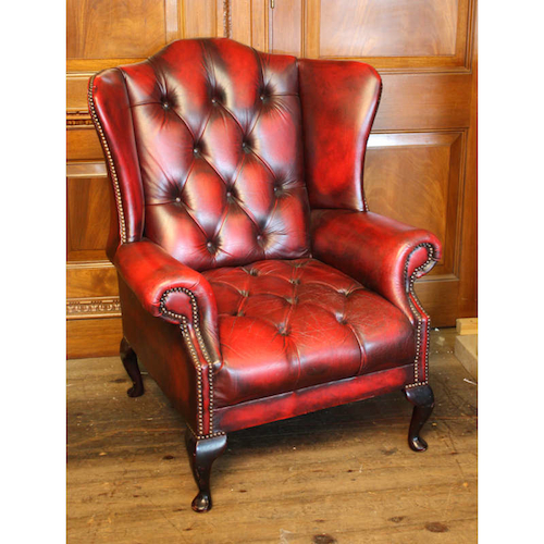 Oxblood leather wing chair.jpg