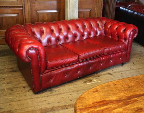 Vintage red leather Chesterfield sofa.jpg